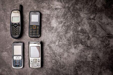 Many obsoleted cellphones on a grunge Standard-Bild
