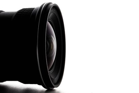 Close up of camera lens with a white background. Archivio Fotografico