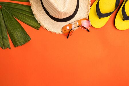 Accessories for summertime on an orange