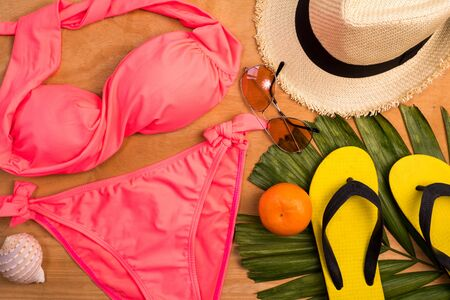 Accessories for summertime on a wooden