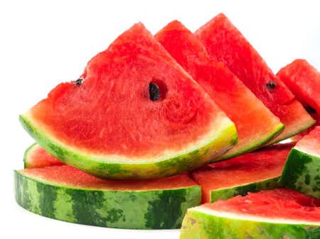 Pile of fresh sliced watermelon on white background. Foto de archivo