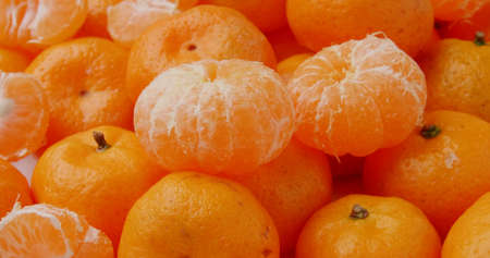 Fresh mandarin oranges fruit or tangerines in basket.