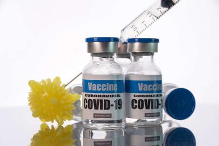 Glass vials for Covid-19 vaccine on white background. Group of Coronavirus vaccine bottles.