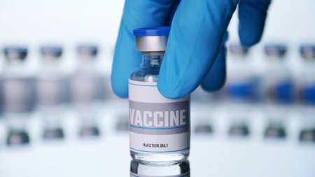 Close up, Scientist is holding a glass vial for vaccine in laboratory. Stock fotó