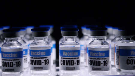 Glass vials for Covid-19 vaccine in laboratory. Group of Coronavirus vaccine bottles. Medicine in ampoules.