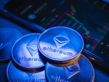 Ethereum coins with stock graph background. Digital currency concept. Archivio Fotografico