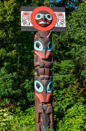 Native Art Totem Pole in Vancouver, British Columbia photo