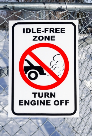 idling: Idle-Free Zone, Turn Engine Off Sign on a Fence