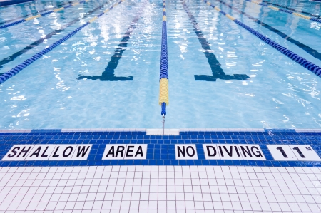 Shallow area of swimming pool, no diving