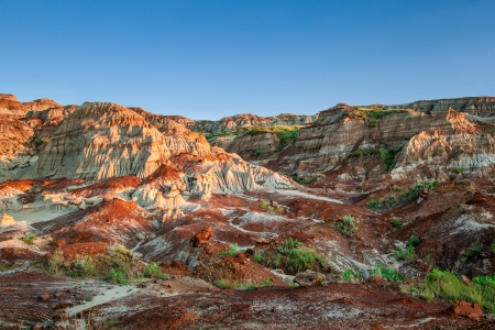 Near sunset over the Drumheller badlands at the Dinosaur Provincial Park in Alberta, where rich deposits of fossils, including dinosaur bones, have been found  The park is now an UNESCO World Heritage Site
