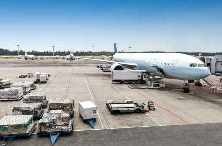 A commercial aircraft being serviced on the tarmac of an international airport Stok Fotoğraf - 24938851