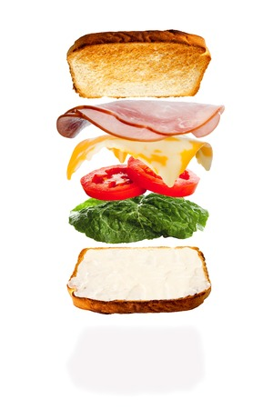 All the ingredients of a melted cheese and ham sandwich falling into place photo