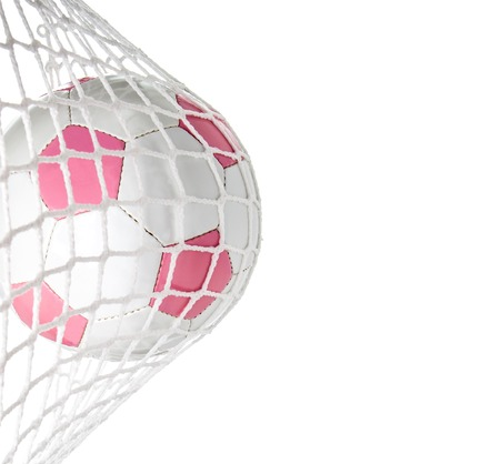 Pink soccer ball in goal with copy space on right photo