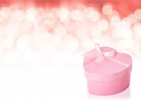 Heart-shaped, polka dot gift box with copy space Stock Photo