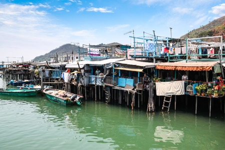 Houses on stilts above the tidal flats of Lantau Island are homes to the Tanka people in Tai O, Hong Kong  These unusual structures are interconnected, forming a tightly knit fishing community that literally lives on the water for generations