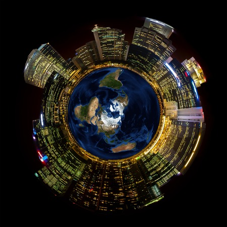Bright city lights on miniature planet photo