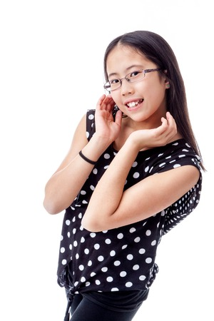 13 14 years: Asian tween girl with a cute pose, isolated on white background Stock Photo