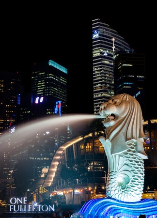 merlion: The Singapore Merlion Park at Marina Bay  The Merlion is a half-lion, half-fish sculpture and the most recognized symbol of Singapore  Editorial