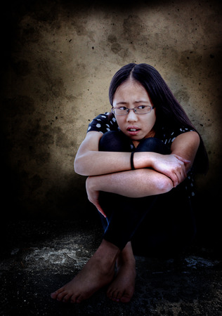 distressed: Distressed and frightened Asian tween, with copy space  Stock Photo