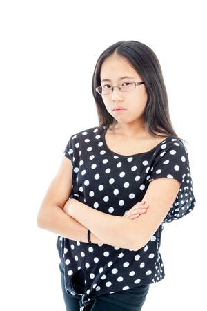 Asian tween girl with folded arms showing displeasure photo