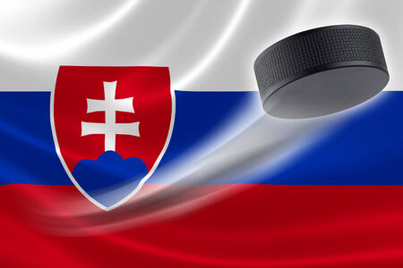Hockey puck streaks across the flag of Slovak Republic, where the country is one of the worlds major ice hockey nations. photo