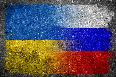 merged: Flags of Russia and Ukraine merged and painted on a wall  Stock Photo