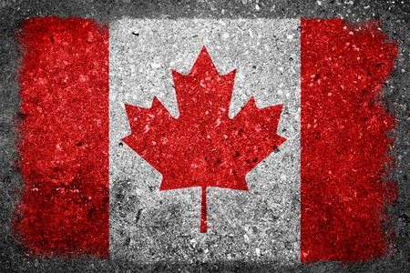 Flag of Canada painted on a grunge concrete grunge wall  photo
