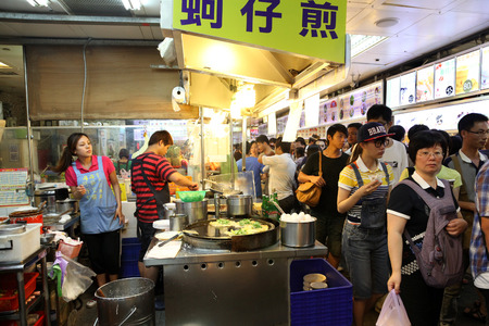 food court: TAIPEI, TAIWAN - JULY 14  Hungry crowds flock to the Shilin Night Market food court in the Shilin District of Taipei July 14, 2013  Shilin Market is the most popular and largest night market in Taiwan