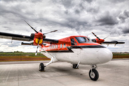 cessna: Vintage propeller plane on an airport tarmac ready for takeoff Editorial