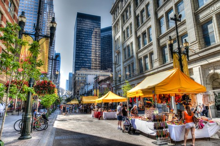Tourists and Calgarians alike stroll along Stephen Avenue Walk, a popular and busy pedestrian mall Stephen Avenue Walk in downtown Calgary is a National Historical District with over 30 restored buildings in the area that feature architectural styles fro