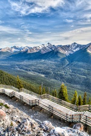 mountain peek: Interpretive walkway on the summit of Sulphur Mountain overlooking mountain ridges in Banff, Alberta, Canada