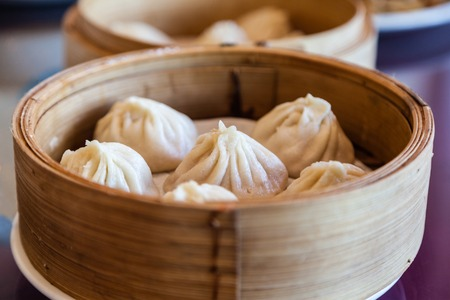 Traditional soup dumpling Xiao Long Bao is a popular Chinese dim sum steamed in bamboo steamers  Stok Fotoğraf