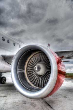 HDR rendering of an airplane engine on the tarmac of an airport  Vertical orientation with copy space  Archivio Fotografico
