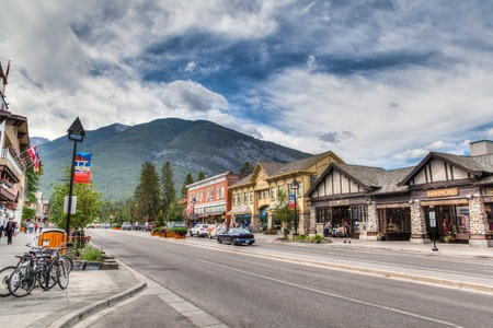 banff: Shoppers stroll along the many retail shops along Banff Avenue in the Banff National Park   Editorial