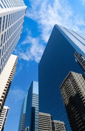 calgary: Tall corporate skyscrapers rise up to the skies in a city downtown. Stock Photo