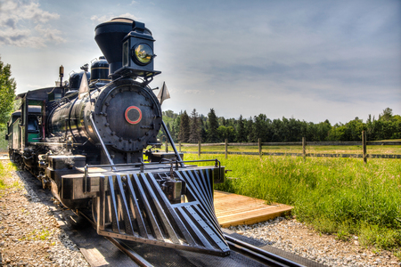 A vintage locomotive steam engine with copy space. photo