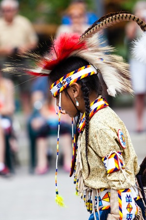 A young native Blackfoot indian dancer performs her native dance during the Banff Summer Arts festival. The Banff Summer Arts Festival is the longest running arts festival in Canada held every summer since 1933.