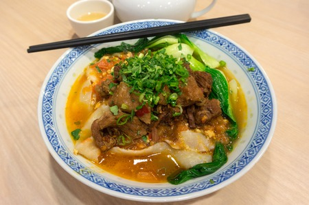 popular soup: A bowl of Chinese handmade knife-cut lamian noodles broiled in braised beef stew. This is a very popular soup noodle dish in Taiwan and Northern China.