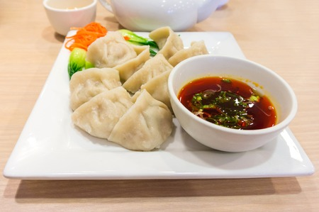 Traditional Chinese Jiaozi Boiled Dumpling With Dipping Sauce