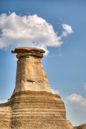 hoodoos: Hoodoos in Drumheller, Alberta. Hoodoos take millions of years to form and stand 5 to 7 metres tall. Each hoodoo is a sandstone pillar resting on a thick base of shale that is capped by a large stone.