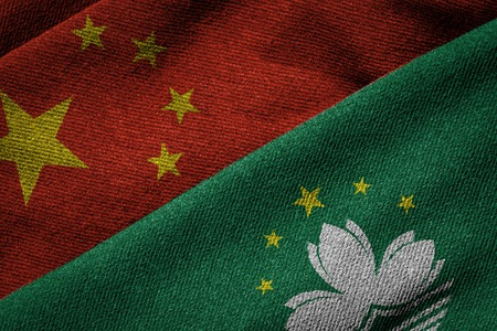 bilateral: 3D rendering of the flags of China and Macau on woven fabric texture. Macau is a Special Administrative Region of China. Detailed textile pattern and grunge theme.