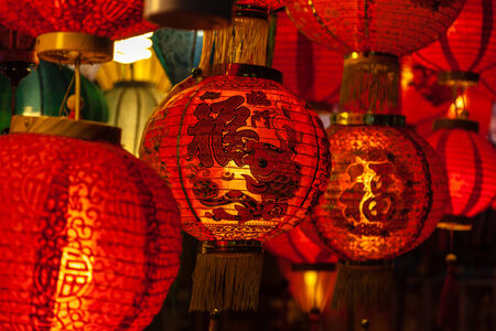 Focus on red Chinese lantern with the Chinese character Blessings written on it. photo