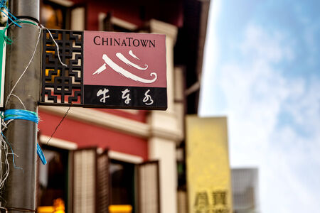 chinatown: A Singapore street sign that reads Chinatown in English and Bull-Cart Water in Chinese. Editorial