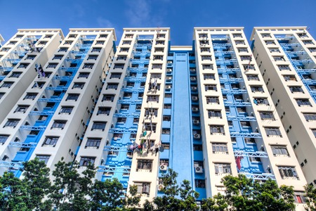 public housing: A typical Singapore highrise public housing estate against a blue sky.