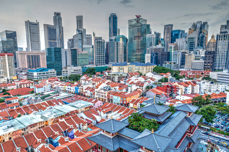 An aerial view of Singapore Chinatown with financial district in background.