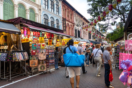 chinatown: Shoppers in Chinatown look for cheap souvenirs and bargains. The old Victorian-style shophouses are a trademark of this popular area.