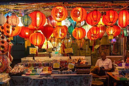 chinatown: A street vendor in Chinatown watches over his store selling Chinese lanterns and souvenirs. Paper lanterns are popular during Chinese New Year and Mid-Autumn Festivals.