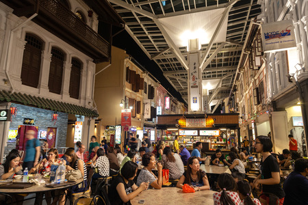 singapore city: Diners eating on Smith Street in the heart of Chinatown. This outdoor street dining experience is dubbed the Chinatown Food Street and features food stalls offering authentic local dishes.