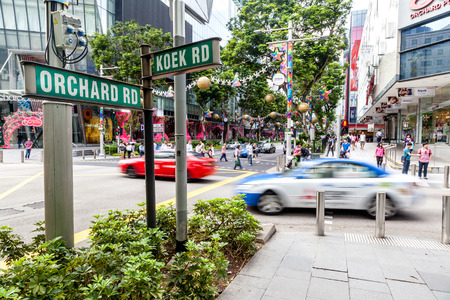 Shoppers and tourists walk along the corner of Orchard Road and Koek Road during Christmas season. The area is the prime shopping and entertainment district of Singapore.