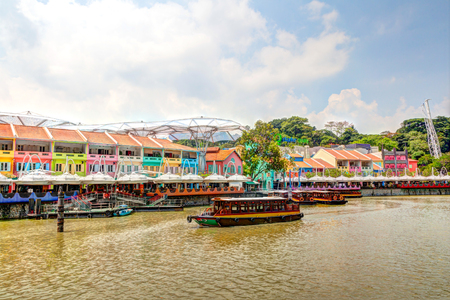 Colorful bars and restaurants dot the Singapore River along Clarke Quay. The area used to be a commercial center during the colonial era where warehouses are located. Now, it is converted into a popular meeting place for locals and tourists alike. HDR ren Editorial
